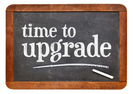 Time to upgrade reminder - white chalk text on a vintage slate blackboard