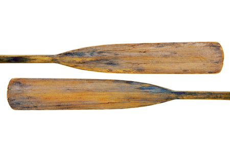 isolated blades of two old wooden weathered paddles (oars) with stains and cracks
