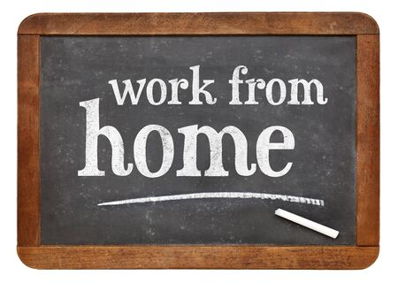 work from home: Work from home advice - white chalk text  on a vintage slate blackboard