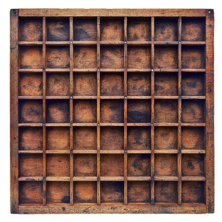 compartments: vintage wood  printer  (typesetter) drawer or shadow box with numerous dividers, isolated on white