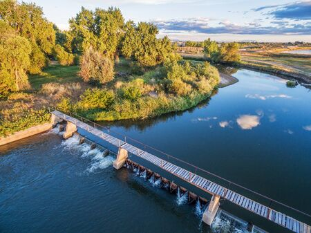 water flow: aerial view of the diversion dam providing water for farming - Cache la Poudre River near WIndsor, Colorado, late summer morning