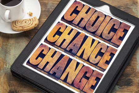 cs: choice, chance and change word abstract  - 3 Cs in life concept  - text in letterpress wood type printing blocks on a digital tablet with a cup of coffee Stock Photo