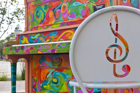 fort collins: FORT COLLINS, CO, USA, JJULY 17, 2012:  One of pianos painted within Pianos About Town program,  artist - Diane Findley, old town of Fort Collins. Editorial
