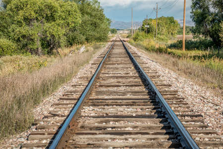 foothills: railroad tracks leading to distant foothills of Rocky Mountains in northern Colorado