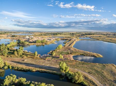 poudre river: Aerial view of a typical landscape in north eastern Colorado along the Poudre River: gravel quarry, ponds, farmland and towns, late summer morning Stock Photo