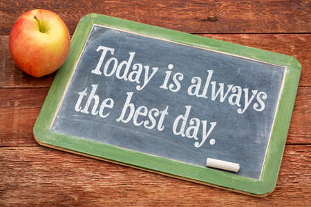 Today is always the best day - positive words on a slate blackboard against red barn wood Stock fotó