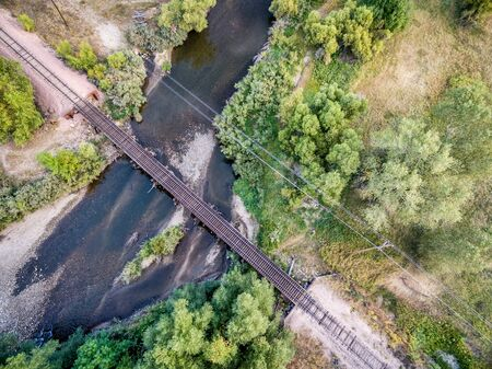 poudre river: aerial view of single railroad tracks in back country crossing a river
