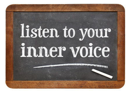 intuition: Listen to your inner voice advice - white chalk text on a vintage slate blackboard