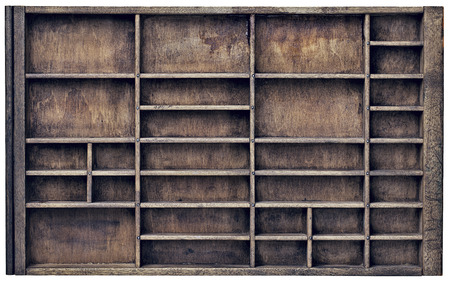 typesetter: vintage wood  printer  (typesetter) drawer with numerous dividers, isolated on white
