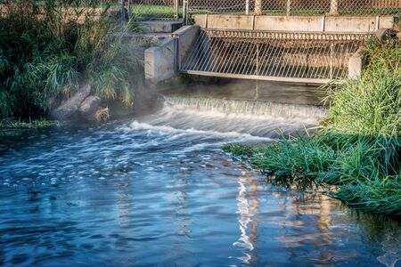 reclamation: Processed and cleaned sewage flowing out from water reclamation facility to a river