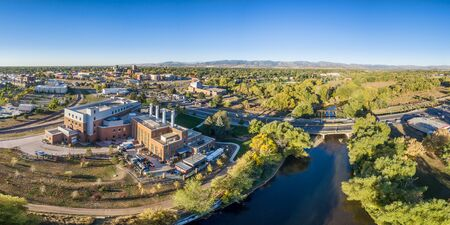 cache la poudre: aerial panorama of Fort Collins downtown with the Cache la Poudre River, fall scenery Stock Photo
