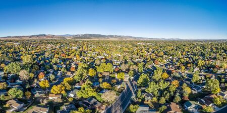 collins: aerial panorama of Fort Collins in northern Colorado - residential buildings with Rocky Mountains foothills in background