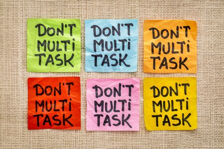 multitask: do not multitask sticky note abstract - efficiency and productivity advice Stock Photo