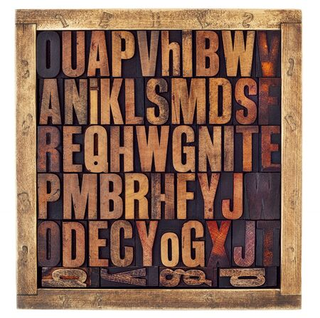 letterpress letters: random letters of alphabet - vintage letterpress wood type printing blocks in a rustic box isolated on white Stock Photo