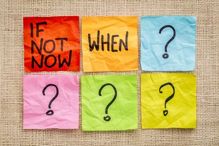 when: If not now when? Call for action or decision - sticky note abstract. Stock Photo