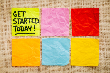 today: Get started today reminder - handwriting on a sticky note against burlap canvas with blank notes