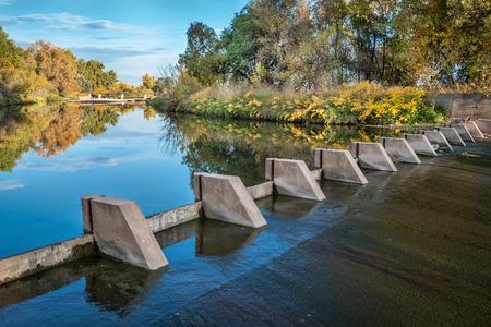 poudre river: river diversion dams providing water for farming - Cache la Poudre River near WIndsor, Colorado, autumn scenery Stock Photo