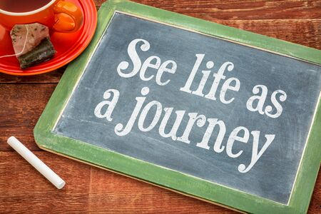 See life as journey - inspiration phrase on a slate blackboard with chalk and cup of tea Фото со стока