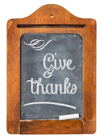 chalk board: Give thanks - Thanksgiving concept - white chalk text on small slate blackboard
