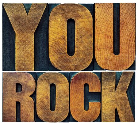 rocks: you rock word abstract - isolated text in grunge letterpress wood type
