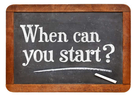 when: When can you start question - white chalk text on a vintage slate blackboard