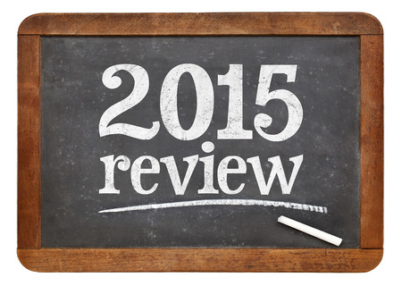 2015 review - year summary concept on a vintage slate blackboard 스톡 사진