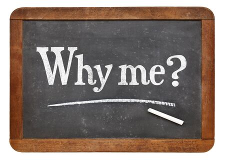 Why me question - a white chalk text on a vintage slate blackboard