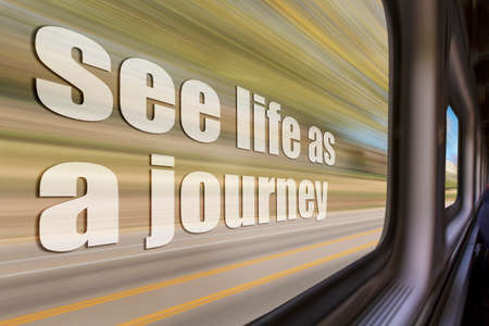 see life as a journey inspirational phrase against a blurred  landscape as seen from a  train window in motion