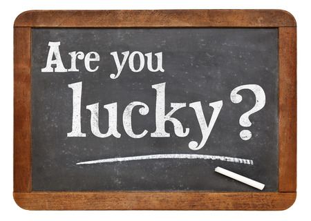 Are you lucky question on a vintage slate blackboard 스톡 사진