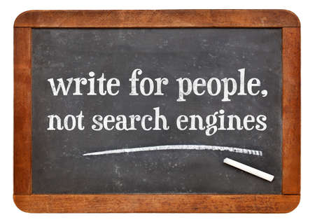 write for people, not search engine - creating content advice - white chalk text on a vintage slate blackboard 스톡 사진