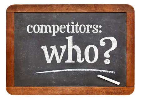 Who is your competitor concept, competitors - who? A white chalk text on a vintage slate blackboard 스톡 사진