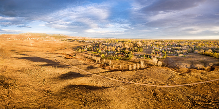 fort collins: aerial panorama of foothills prairie and residential areas along Front Range of Rocky Mountains near Fort Collins, Colorado, fall scenery lit by sunrise