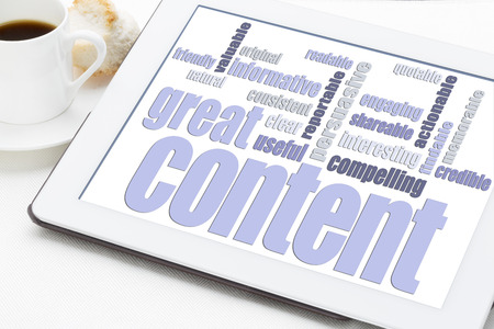 credible: great content word cloud on a digital tablet with a cup of coffee - bloging and content marketing concept