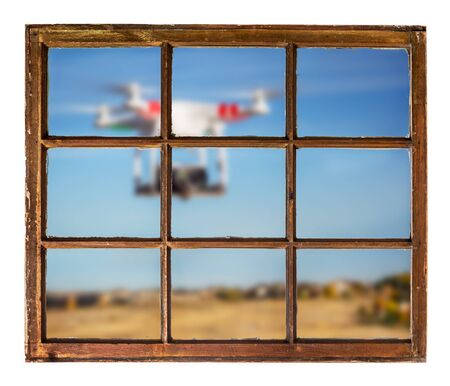 drones and privacy violation concept - blurred drone flying with a camera outside the window 스톡 사진