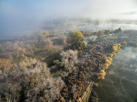cottonwood tree: foggy November sunrise over Cache la Poudre River in northern Colorado near WIndsor