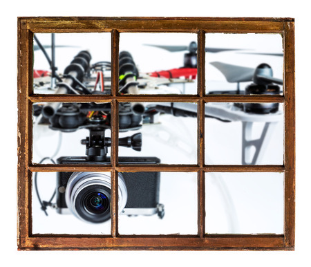 drones and privacy invasion concept - blurred oversized drone flying with a camera outside the window