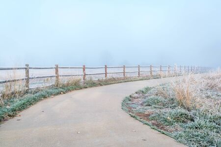 northern Colorado bike trail in fog - November morning on the Poudre River Trail near WIndsor