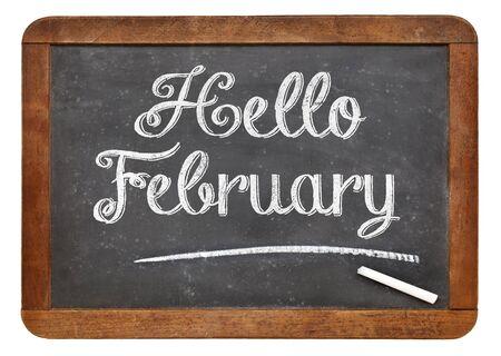 こんにちは 2 月記号 - 白いチョーク分離のビンテージ スレート黒板上のテキスト