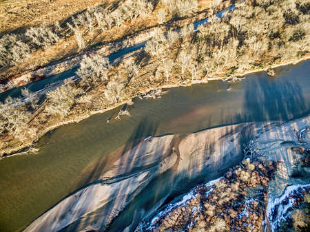 south platte river: aerial view of South Platte River in eastern Colorado with a canoe on sandbar, fall scenery Stock Photo