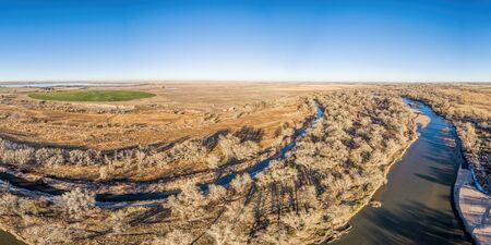 aerial view of eastern Colorado landscape with South Platte River,  water channels, reservoirs and irrigated farmland