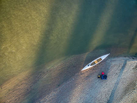 expedition: aerial view of expedition decked canoe on a sandbar, South Platte River in eastern Colorado Stock Photo