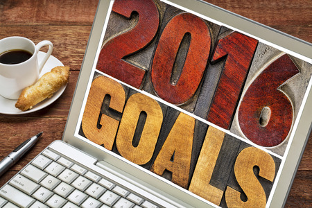 2016 goals - New Year resolution concept - isolated text in vintage letterpress wood type printing blocks on a laptop screen with a cup of coffee Stock Photo - 48599368