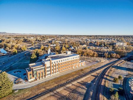 municipal editorial: FORT COLLINS, CO, USA - NOVEMBER 15, 2015: Powerhouse Energy Campus of Colorado State University - aerial view at a new building completed in 2014 and historic Fort Collins Municipal Power Plant behind it.
