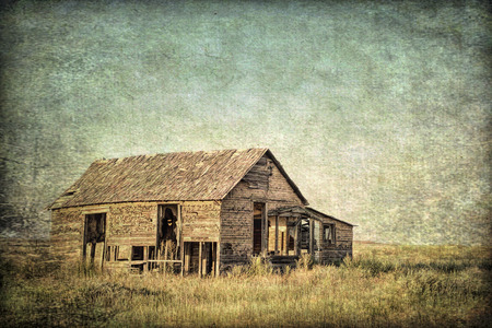 gritty: old abandoned homestead on eastern Colorado prairie, grunge and gritty texture picture finish