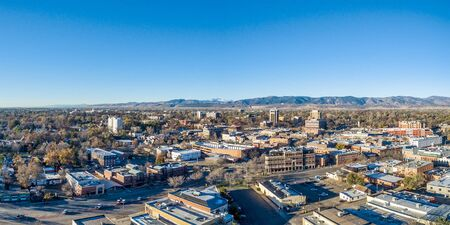 collins: Fort Collins downtown aerial panorama,  fall  scenery od Colorado with Front Range of Rocky Mountains in background