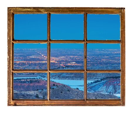horsetooth reservoir: Fort Collins, Colorado, cityscape at night - abstract view from a sash window of old  mountain cabin