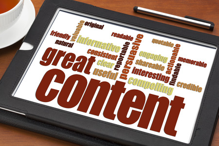 content writing: great content writing word cloud on a digital tablet with a cup of tea- bloging, business writing and content marketing concept Stock Photo
