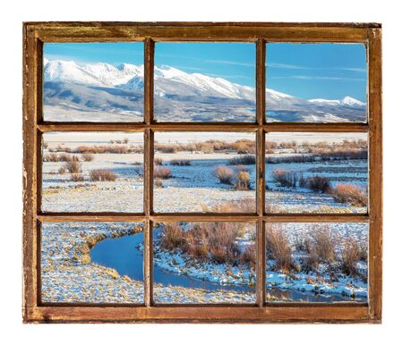 sash: travel concept or a greeting card from Colorado - river valley and snowy mountains  as seen  through vintage, grunge, sash window with dirty glass