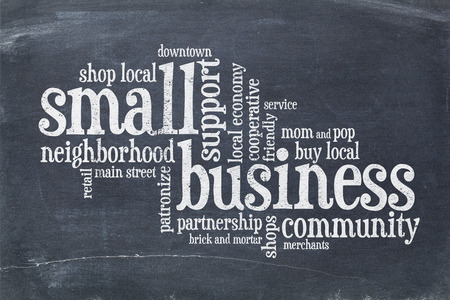 small business concept - word cloud on a vintage slate blackboard Banco de Imagens