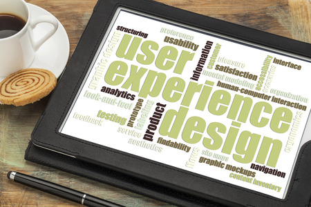 user: user experience design concept - word cloud on a digital tablet with a cup of coffee Stock Photo